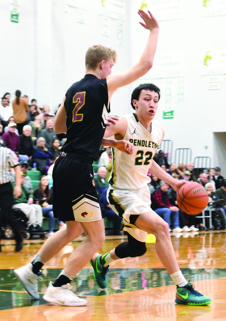 Stockton Hoffman works against a defender on the edge of the paint.