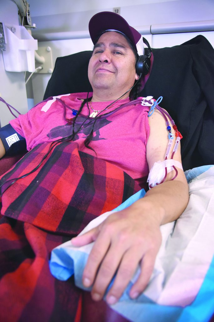 Wus Gone sits in a chair at the DaVita Dialysis Center on the Umatilla Indian Reservation. Gone spends four hours, three days a week, on a machine that does the work his kidney is supposed to do. He was born with one kidney and it no longer functions. Now he's waiting for a kidney transplant.