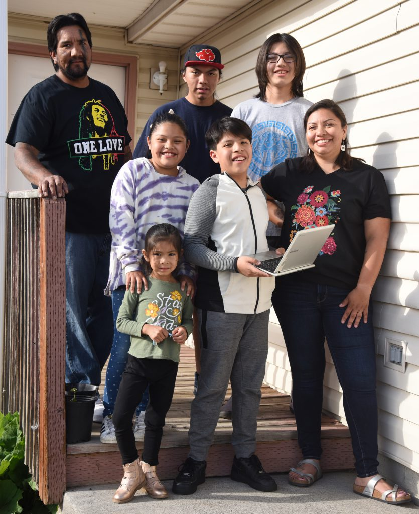Talia Tewawina, bottom right, is a warrior mom, keeping her five children on track during the COVID-19 pandemic with a daily schedule that includes schoolwork, chores, exercise and freetime while she works a part-time job at Yellowhawk Tribal Health Center on the Umatilla Indian Reservation. The family, which lives in Pendleton, includes husband Andrew, plus the children, Midnight Rose Tewawina at the bottom, Ayanna and Ayden Star in the middle next to their mother, and Anthony and Leo Crawford on the top step.